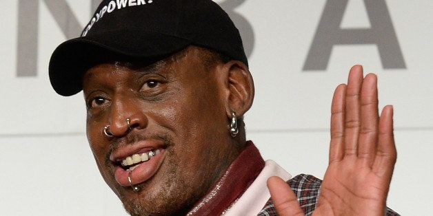 Former NBA star Dennis Rodman poses during a press conference in Tokyo on October 25, 2013. Rodman is here to promote NBA ahe