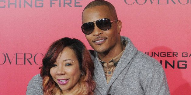 LOS ANGELES, CA - NOVEMBER 18:  Rapper T.I. and wife Tameka 'Tiny' Harris arrives at the Los Angeles Premiere 'The Hunger Gam