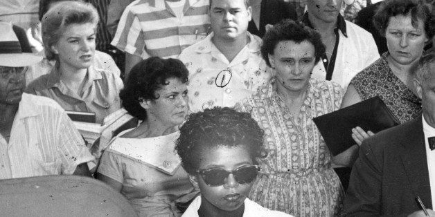 American teenager Elizabeth Eckford (center bottom, in suglasses) is followed by a crowd as she walks to school, Little Rock,