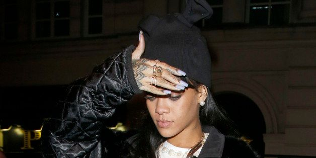 LONDON, UNITED KINGDOM - MARCH 27: Rihanna seen arriving at the private members club Tramp with Drake on March 27, 2014 in Lo
