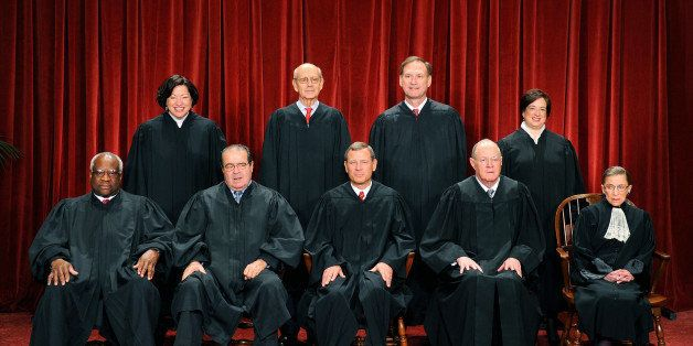 The Justices of the US Supreme Court sit for their official photograph on October 8, 2010 at the Supreme Court in Washington,