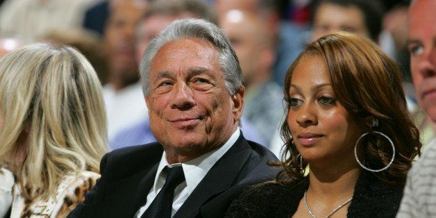 DENVER - APRIL 29:  Los Angeles Clippers owner Donald Sterling (L) watches game four of the Western Conference Quarterfinals