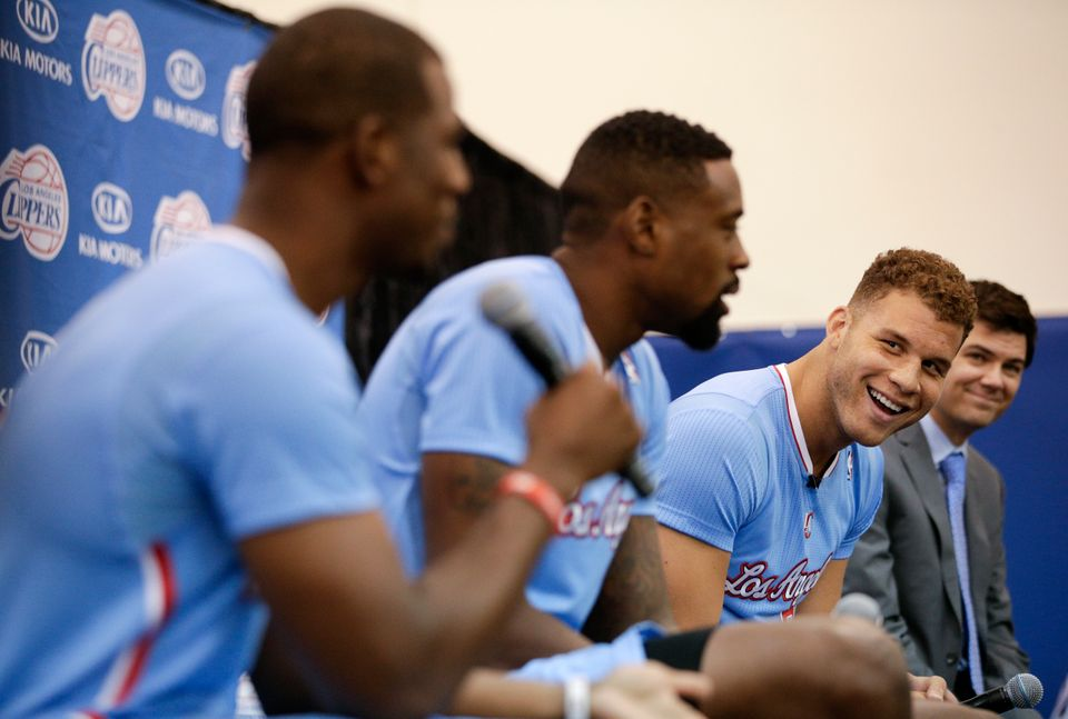 Los Angeles Clippers' Blake Griffin, right, with DeAndre Jordan, center, watches teammate Chris Paul answer a question during