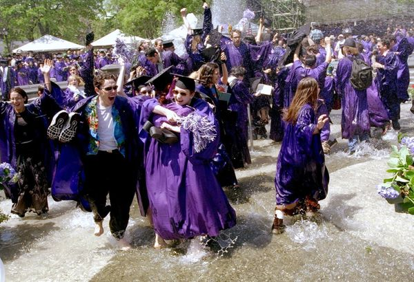 After graduation at NYU, students like to cool off by jumping in New York's Washington Square fountain, still wearing their f