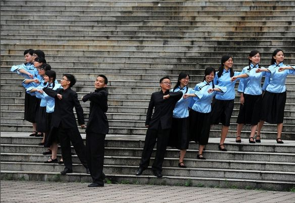 Graduate students dressed in old time clothing pose for photos for their graduation at Sun Yat-sen University on June 27, 201