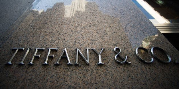 Tiffany and Co. signage is displayed outside the company's flagship store in New York, U.S., on Tuesday, March 18, 2014. Tiff
