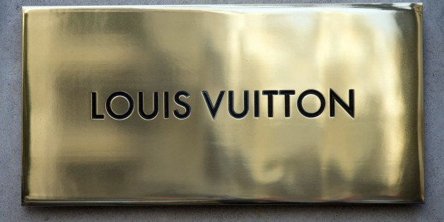The Louis Vuitton store name is pictured above the facade of a shop, on December 26, 2012 in Paris. AFP PHOTO / JOEL SAGET