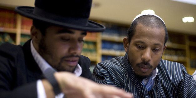 TO GO WITH AFP STORY BY SARA HUSSEIN US Jewish rapper Shyne (R) studies the Torah at the Esh Hatora yeshiva in Jerusalem on N