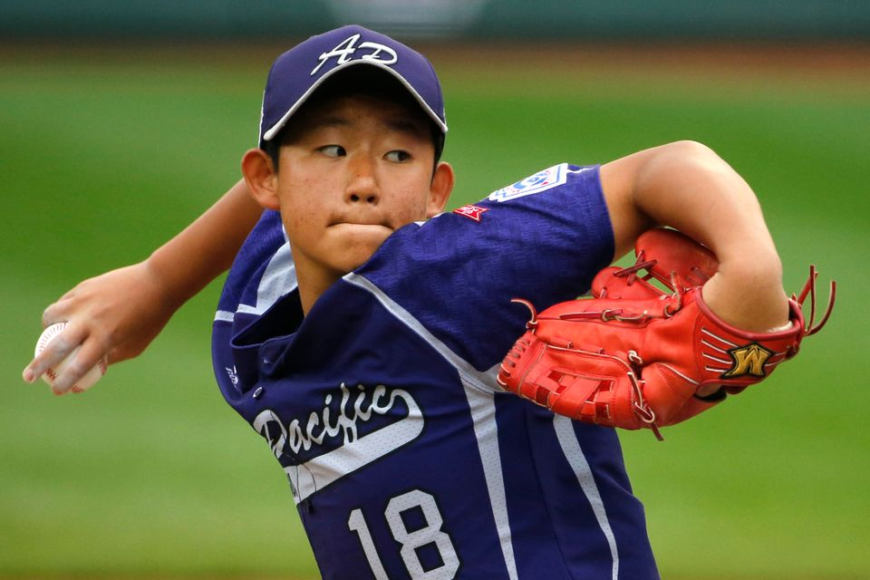 South Korea's Jae Yeong Hwang (18) delivers during the first inning of an International Championship baseball game against Ja