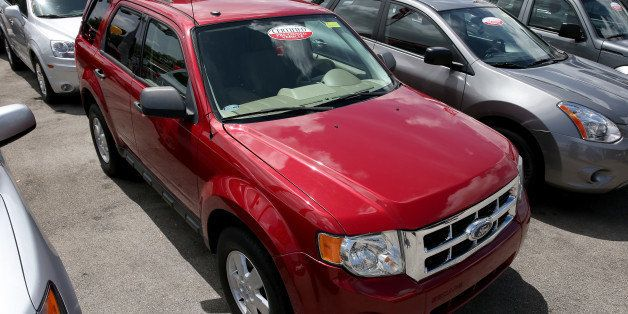 MIAMI, FL - MAY 30:  A 2010 Ford Escape is seen on a used car lot on May 30, 2014 in Miami, Florida. Ford announced a recall