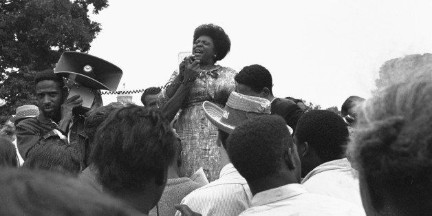 Mrs. Fannie Lou Hamer of Ruleville, MS, speaks to Mississippi Freedom Democratic Party sympathizers outside the Capitol in Wa