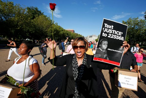 Missouri state Sen. Jamilah Nasheed (D) walks during a rally for justice for Michael Brown, and the people of Ferguson, Misso