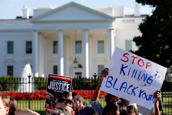 A sign is held during a rally for justice for Michael Brown, and the people of Ferguson, Missouri on Pennsylvania Avenue in f
