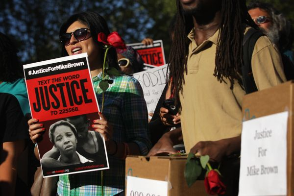 Demonstrators in front of the White House on Thursday called on the Justice Department to fully investigate, prosecute, and f