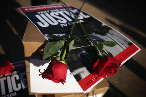 Roses and a poster are seen on top of nearly 950,000 signatures that are delivered to the White House August 28, 2014 on Thu