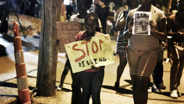 On the evening of August 22nd, children joined the marched that circled W Florrisant in Ferguson to protest the shooting of M