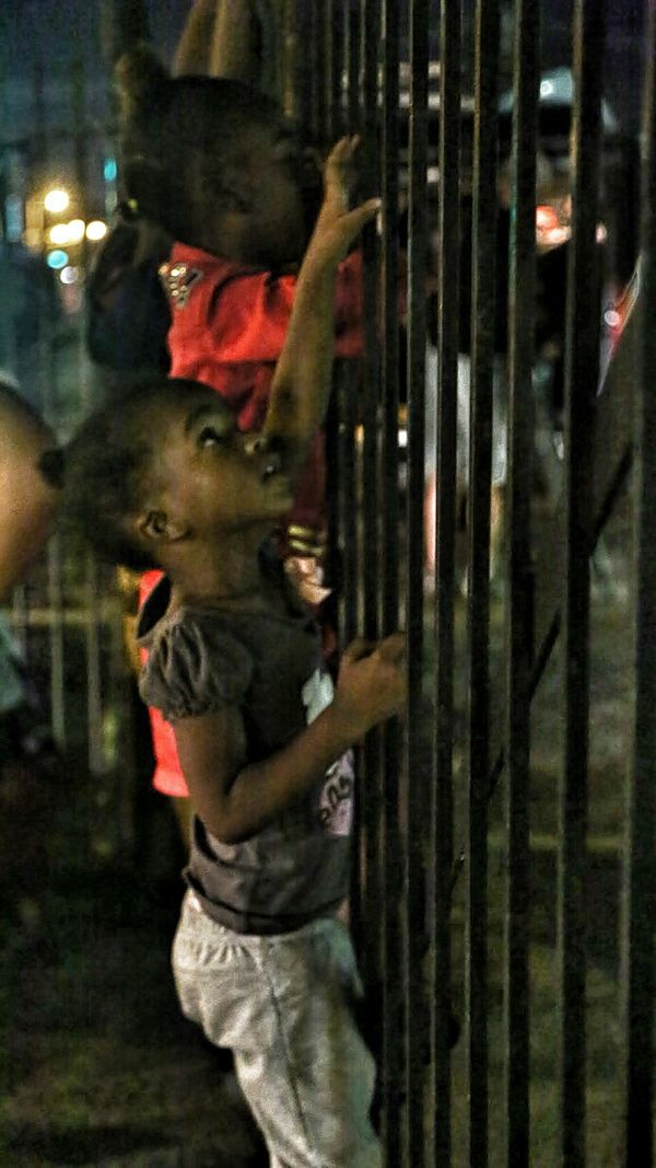 While protesters marched on W. Florissant on August 21st, kids played on the fences surrounding a parking lot while their fam