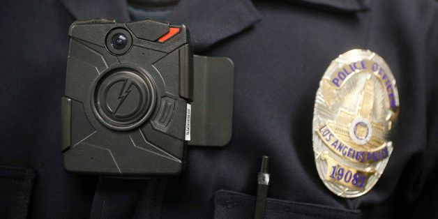 This Jan. 15, 2014 file photo shows a Los Angeles Police officer wearing an on-body cameras during a demonstration for media