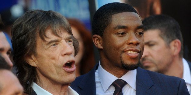 """Mick Jagger and Chadwick Boseman attend the premiere of Universal Pictures' """"Get On Up"""" at the Apollo Theater in New York on"""