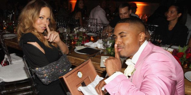 NEW YORK, NY - SEPTEMBER 12:  Mariah Carey gives Nas a Louis Vuitton Cigar Humidor as Joel Kinnaman and Olivia Munn look on a