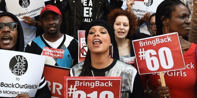 US singer-songwriter Alicia Keys (C) shouts slogans as she joins protesters with the 'Bring Back Our Girls' campaign during a