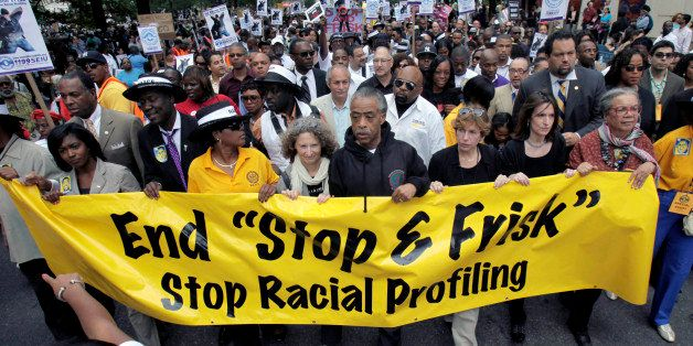 FILE - In this June 17, 2012, file photo, the Rev. Al Sharpton, center, walks with demonstrators during a silent march to end