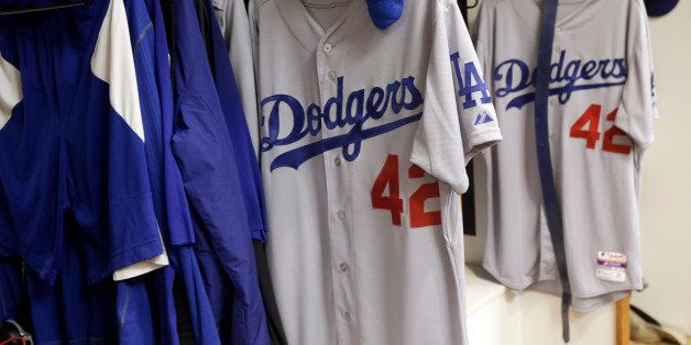 Jerseys with Jackie Robinson's No. 42 hang in the Los Angeles Dodgers' locker room before a baseball game between the Dodgers