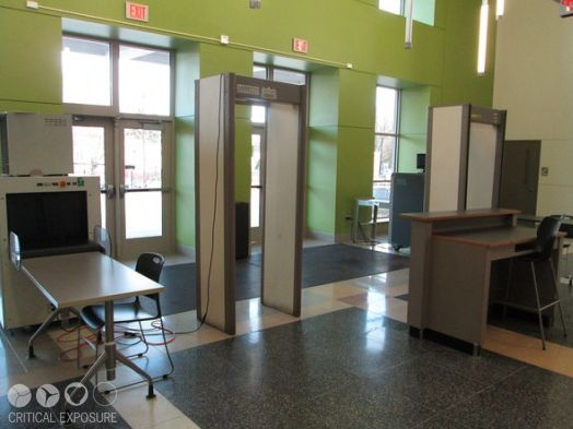 "<em>""Everyday students have to enter through the auditorium doors and place their backpacks on the X-Ray machine. Then they w"
