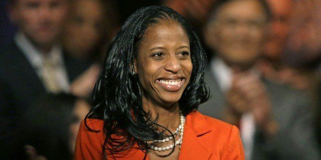In this Wednesday, Oct. 8, 2014, photo, Mia Love, the Republican nominee in Utah's 4th congressional district, smiles after