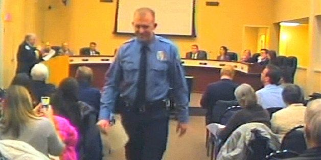 FILE - In this  Feb. 11, 2014 file image from video provided by the City of Ferguson, Mo., officer Darren Wilson attends a ci