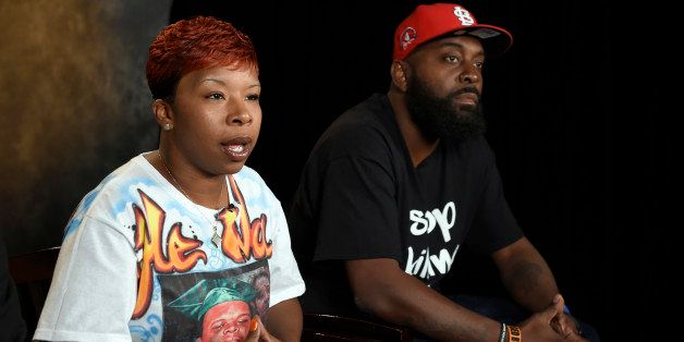 The parents of Michael Brown, Lesley McSpadden, left, and Michael Brown, Sr., right, sit for an interview with The Associated