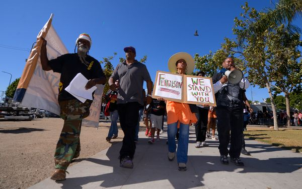 Protesters march through Leimert Park to protest the shooting of an unarmed man in Ferguson, Mo., and other victims of police
