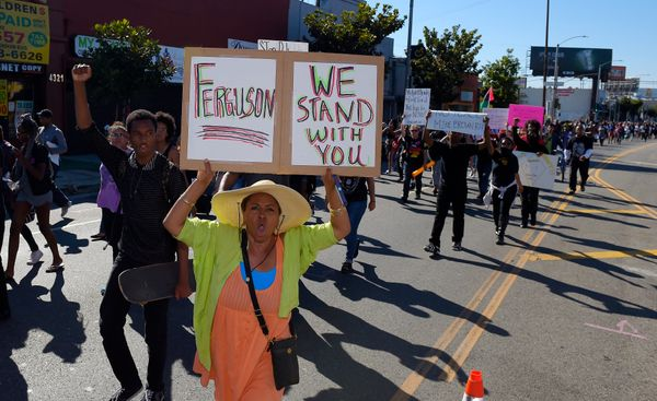 Protesters walk in the middle of Crenshaw Blvd. to protest the shooting of an unarmed man in Ferguson, Missouri and other vic