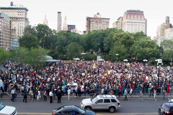 Protesters march in New York City's Union Square, Thursday, Aug. 14, 2014. Vigils are being held across the country for peo