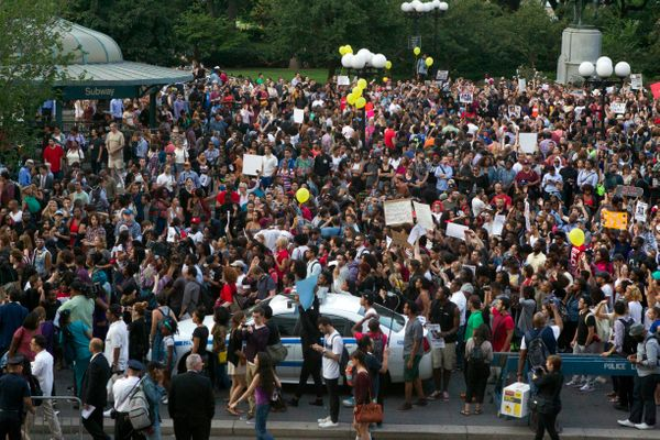 About 1000 people march peacefully in New York City's Union Square, Thursday, Aug. 14, 2014. Vigils are being held across t