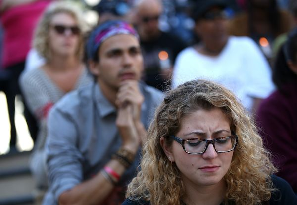OAKLAND, CA - AUGUST 14:  Demonstrators look on during a moment of silence on August 14, 2014 in Oakland, California. Hundred