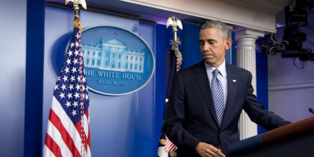 President Barack Obama leaves the Brady Press Briefing Room at the White House in Washington, Monday, Nov. 24, 2014, after th