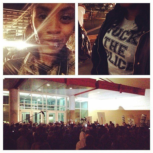 People protest the Darren Wilson Grand Jury decision in Dallas, Texas on November 25, 2014