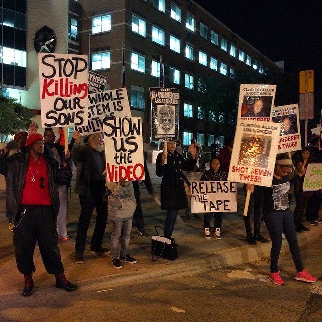 People protest the Darren Wilson Grand Jury decision in Dallas, Texas, on November 25, 2014.