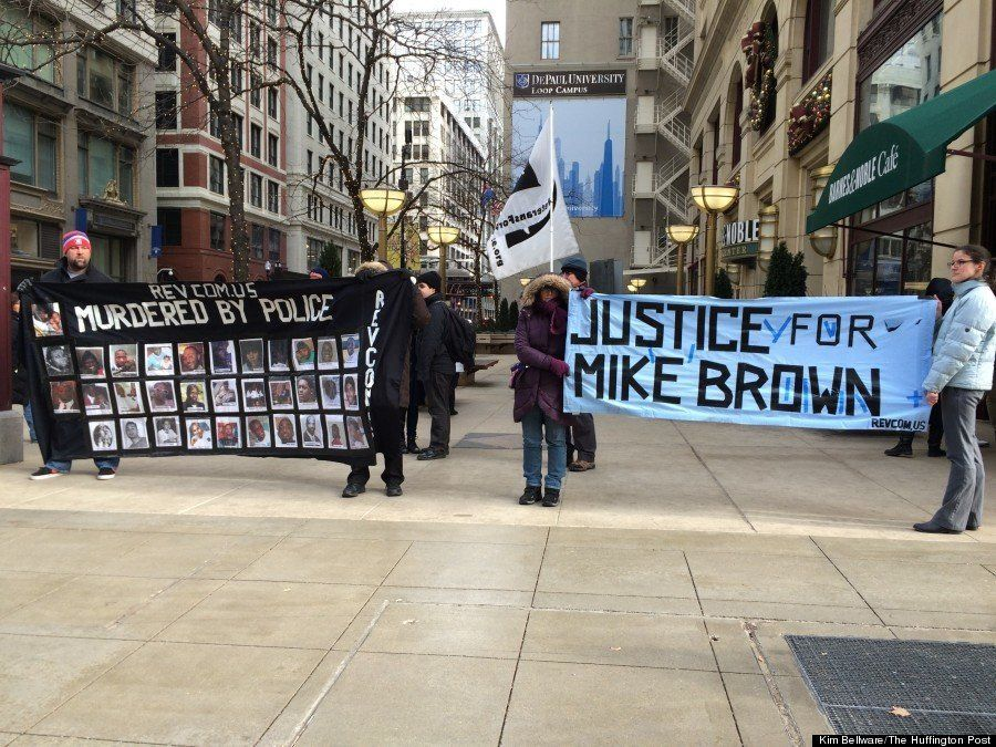 Protestors gather in the Loop in downtown Chicago during one of several Ferguson-related demonstrations taking place Monday.