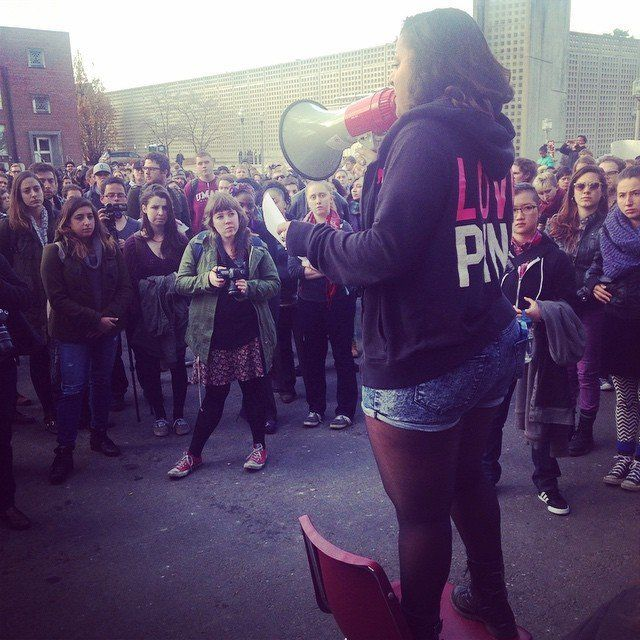 Students at the University of Massachusetts take part in a walkout on Dec. 1, 2014.