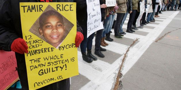 Demonstrators block Public Square Tuesday, Nov. 25, 2014, in Cleveland, during a protest over the weekend police shooting of