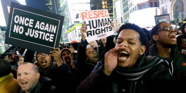 Protestors shout at Times Square after it was announced that the New York City police officer involved in the death of Eric G