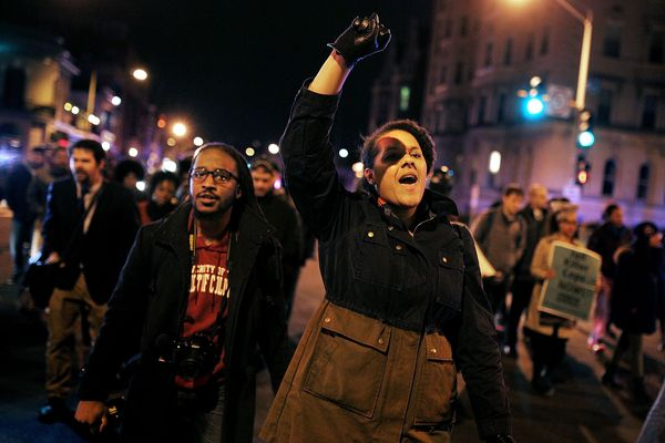 WASHINGTON, DC - DECEMBER 03:  Demonstrators march in the street during a protest against a New York grand jury December 3, 2