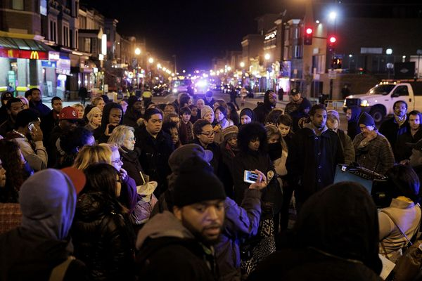 WASHINGTON, DC - DECEMBER 03:  Demonstrators block an intersection in the Adams Morgan neighborhood during a protest against