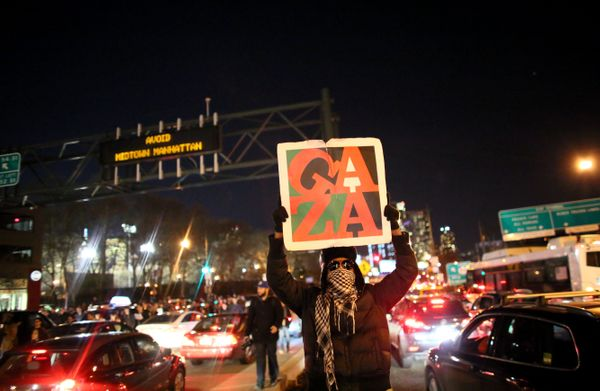 NEW YORK - DECEMBER 3: Protesters walk together on the West Side Highway December 3, 2014 in New York. Protests began after a
