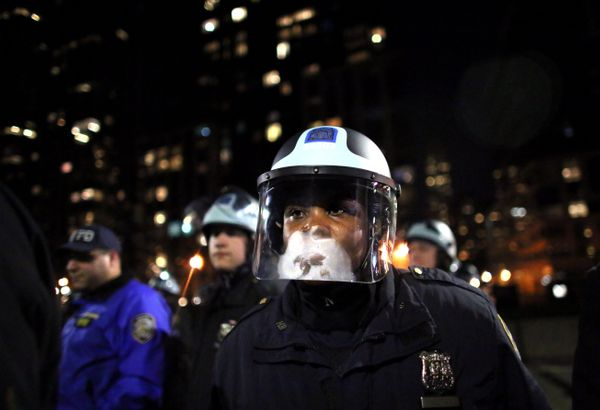 NEW YORK - DECEMBER 3: Police watch protesters on the West Side Highway December 3, 2014 in New York. Protests began after a