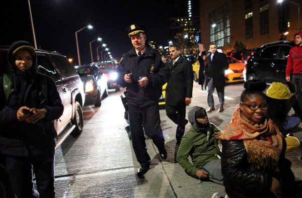 NEW YORK - DECEMBER 3: Police walk through protesters clash on the West Side Highway December 3, 2014 in New York. Protests b