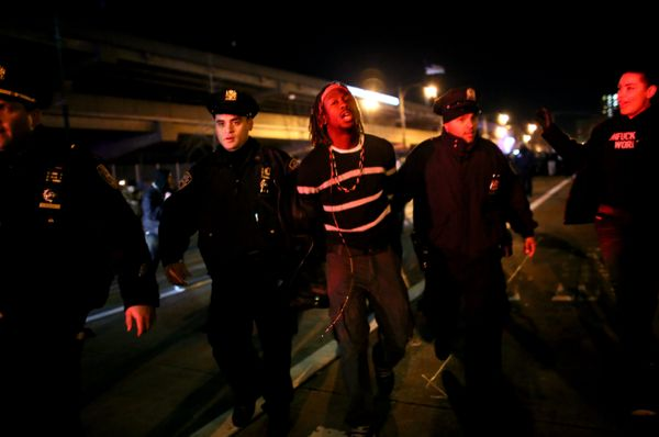 NEW YORK - DECEMBER 3: Police arrest a protester on the West Side Highway December 3, 2014 in New York. Protests began after