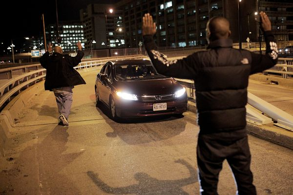WASHINGTON, DC - DECEMBER 03:  Demonstrators block traffic on Highway I-395 during a protest against a New York grand jury de